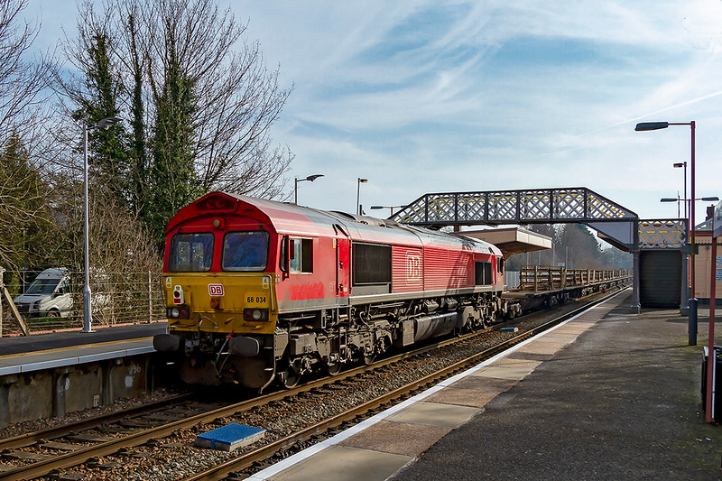 17th Feb 2019:  66034 is riding as shot gun on 6W98 from Keynsham to Eastleigh that was powered by 66093.  If I were a bit more agile I would have  run further down the platform so that the  footbridge shadow would not have been on the loco.  Better than nothing though I think.