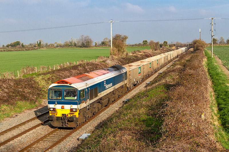 22nd Feb 2019:  The word was that 7C77 from Acton to Merehead should sport two Hansons, 59102 & 59104, on the point, not a common event.  However it was either a change of plan or 104 got lost on the way!  59102 alone is doing the job as it runs through `Edington