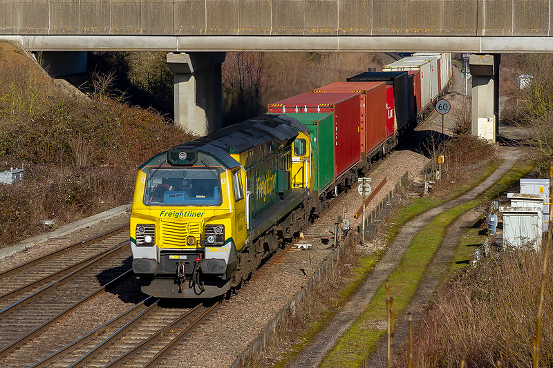 14th Feb 2019:  70008 is powering 4O90 the 05.45 from Leeds to Southampton Maritime Container Terminal at Didcot North Junction