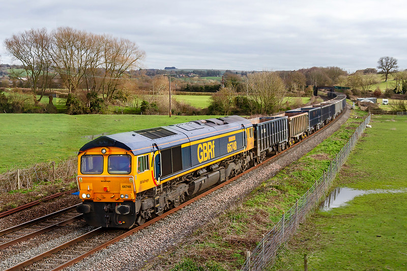 11th Feb 2019:  66748 'West Burton 50' is at Great Cheverell as it brings 6V42 from Wellingborough to Whatley Quarry for the empty boxes to be refilled.