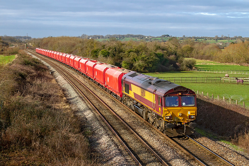 12th Feb 2019:  The new DBC HRAs are still looking pristine, although 16 & 17 have a bit of silver paint on them. it was good to see them without a pink one providing the urge.  6M20 powered by 66014 running through Fairwood as it travels from Whatley Quarry to St Pancras Churchyard Siding