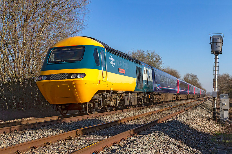 26th Feb 2019:  Going away and soon to be gone for ever.  On the rear of 1A75 the 06.16 Plymouth to Paddington is 43002 'Sir Kenneth Grange' as it races up the Westbury New Line AKA Avoider.  I had hoped that it would be on the front as this is the only chance that I have to picture the set during the day.  43025 is on the other end