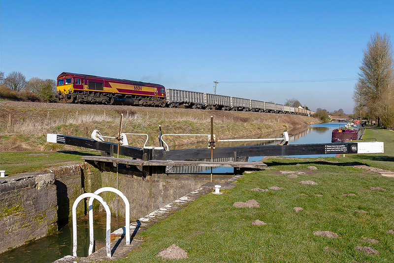 25th Feb 2019: Passing the lock 60 on the Kennet & Avon Canal outside the Crofton Pumping Station is 66014 heading 6C58 from Oxford Banbury Road to Whatley Quarry