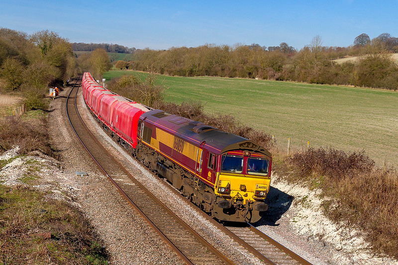 25th Feb 2019:  6M20 from Whatley Quarry to St Pancras Churchyard Siding is today powered by 66050.  The location is the famous Wolfhall Junction jus East of Savernake Station,.  The line of trees on the right  are on the embankment of the long closed direct route through Savernake of the Midland &  Southwestern Junction Railway.