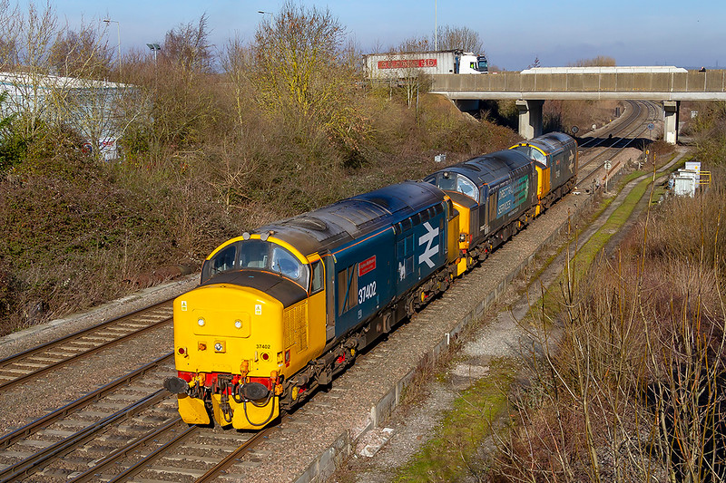 14th Feb 2019:  A real unexpected bonus was the running of 0Z37 from Crewe Gresty Bridge to Arlington ZG with a consist of 3 class 37s.  Leading is 37402 'Stephen Middlemore 23-12 1954 to 08-06-2013', 37602 & 37409 'Lord Hinton'.