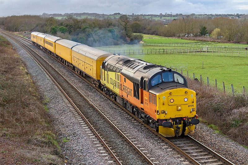 28th Feb 2019:  The day's Tester from Westbury to Westbury via Weymouth and Thingly Junction is on time as it  nears Westbury..  The weather is not inspiring  but a picture of a 37 is always worth the effort.  Colas 37175 is here leading on 3Q60  as it runs through Fairwood.  Had it come two minutes earlier it was full, rather back lit, sun light.