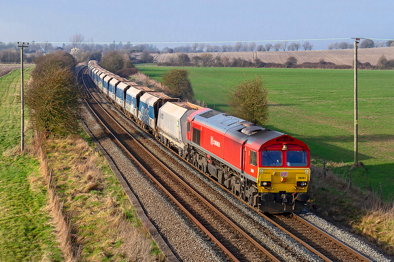 22nd Feb 2019:  59201 has just ended the climb from Westbury to Upton Scudamore and is about to pass under the bridge on the Warminster By Pass.  The service is the Friday Only 7O40 13.35 from Merehead to Eastleigh.  Nice to see that the bell is catching the light.