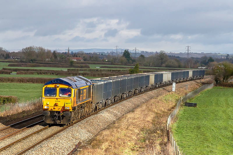 4th Feb 2019: Slowing  for the divergence at Clink Road Junction in Frome is 66777 as it makes for Whatley Quarry with 6V42 from Wellingborough.  The patch of sun was welcome but totally unexpected.