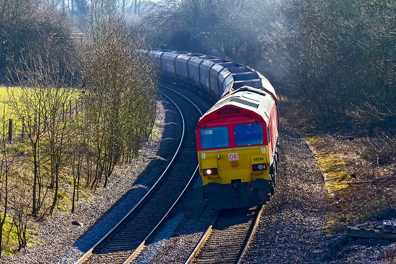 25th Feb 2019:  6C31 in the hands of 59204 is pictured as it crosses the site of Wolfhall Junction near Savernake.  Originally the line Midland & South Western Junction lines would have been branching away to the right at this point.