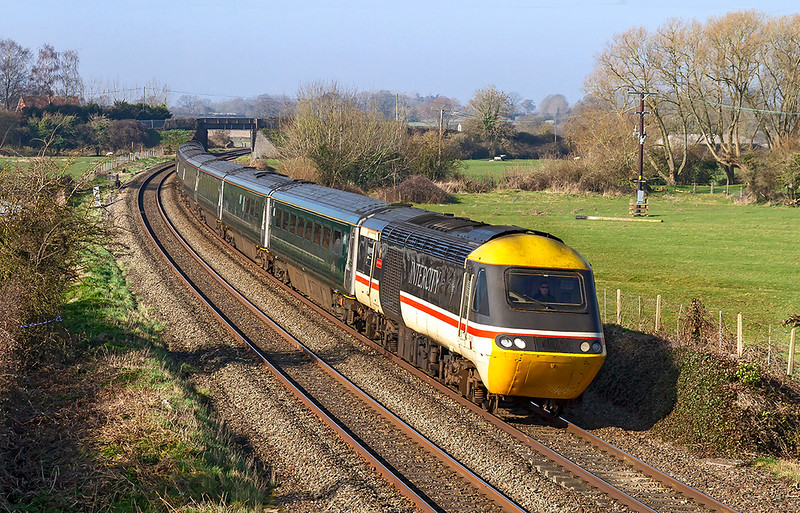 27th Feb 2019:  Running on time through Gt Cheverell is Swallow liveried 43185 on the front of 1A77 the  05.45 from Penzance to Paddington.  43086 is on the other end.