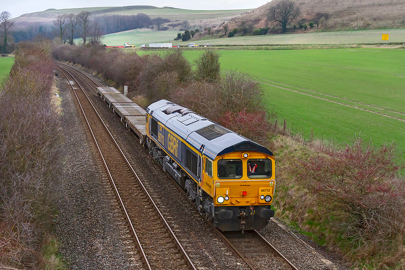 21st Jan 2019:  6M07 is working from Warminster MOD siding to Bicester MOD and is pictured as it nears Heytsbury.  Powered by 66712 it started 15 minutes early and arrived in time.    It would have been good if there were a few Tanks on the flats