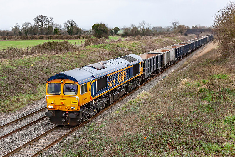 15th Jan 2019:  The final new build class 66 is 66778 now named 'Darius Creskin' hurries through Edington on the Berks & Hants line.  It is working 6V42 the 07.50 from Wellingborough to Whatley Quarry.  66779 was made using recovered parts from 66734 ( originally DRS 66403) which had to be carefully cut up for removal after colliding with a land slide in Scotland