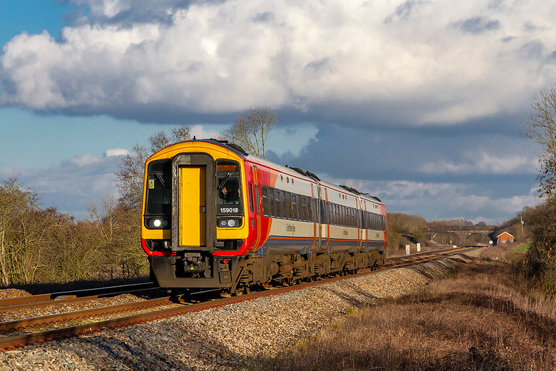 30th Jan 2019:  The South Western RaIlway on the Great Western Railway near Westbury.  1V35 in the hands of 159018 started from Waterloo at 12.50 and is passing Masters Crossing Right Time at 14.59 and is heading to Yeovil Pen Mill