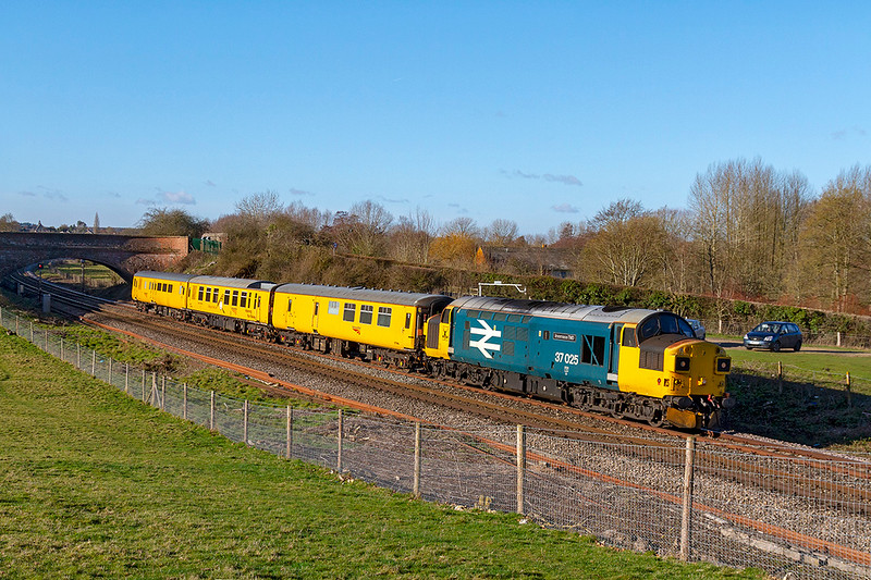 17th Jan 2019:  3Q23  powered by 37025 is at Hungerford as it heads to Ferme Park from Exeter. For the last few days it has been touring the lines in the West of England and it  going to Derby in the morning.  DVT 9701 is on the other end.