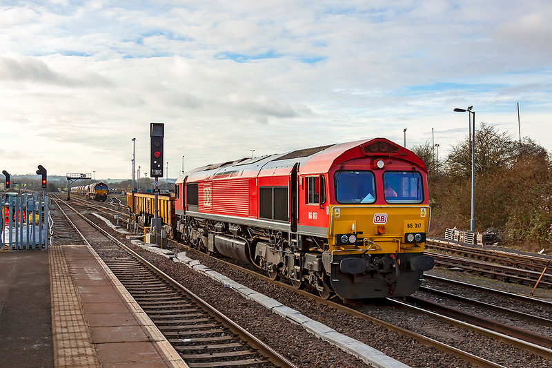 11th Jan 2019:  Passing the new Lolipop signal at the south end of Westbury station 66017 shunts 2 JNAs back into the sidings.  Work is starting at the end of the platform for it to be extended.  66079 can be seen in the distance.