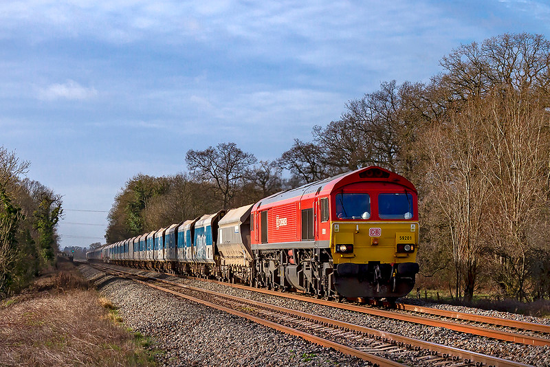 1st Jan 2019:  59201 runs into sunshine as it nears Fairwood Junction as it works 7A77 from Merehead to Theale.  With Freightliner due to take over the Mendip stone workings how much longer will the 592s be seen here?