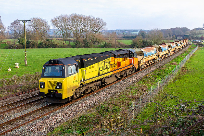 20th Jan 2019:  Captured at Great Cheverell is 70816 on the point of 6C27 that consists of 2 sets of HQAs.  Starting from Hinsey 17 minutes early at 10.27 it is heading for Newton Abbotand where is is due to arrive at just after 3pm.