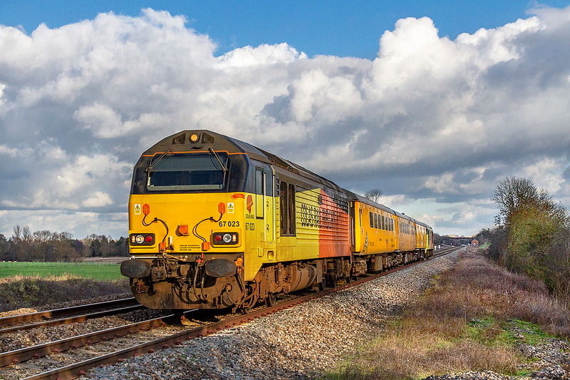 30th Jan 2019:  The regular tester to Weymouth just catches the sun as it runs away from Fairwood.  With 67023 0n the front and 67027 at the rear.  1Z22 started from Tyseley at 09.17 and has been routed via Oxford and will end the duty at Bristol High Level Siding.