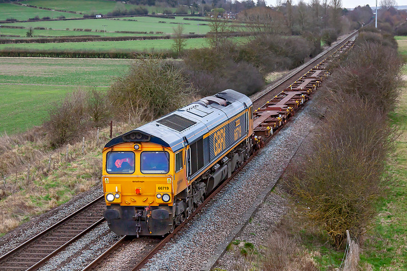 14th Jan 2019:  About to pass under  the Warminster By Pass with a Glider Fuel Express is  GBRf 66719 'Metro Net'.  Actually it is 6M46 the 12.18 from Marchwood MOD to Bicester MOD. A few boxes would have been nice.