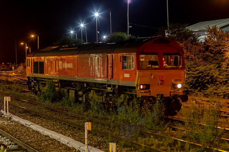 17th Jul 2019:  Parked in the weeds at Westbury is 59203.  This had earlier come from Merehead and was scheduled to follow 70003 on it's test run to Acton with an over 4000 ton train to assist if there was a problem.   It did but help was not required.