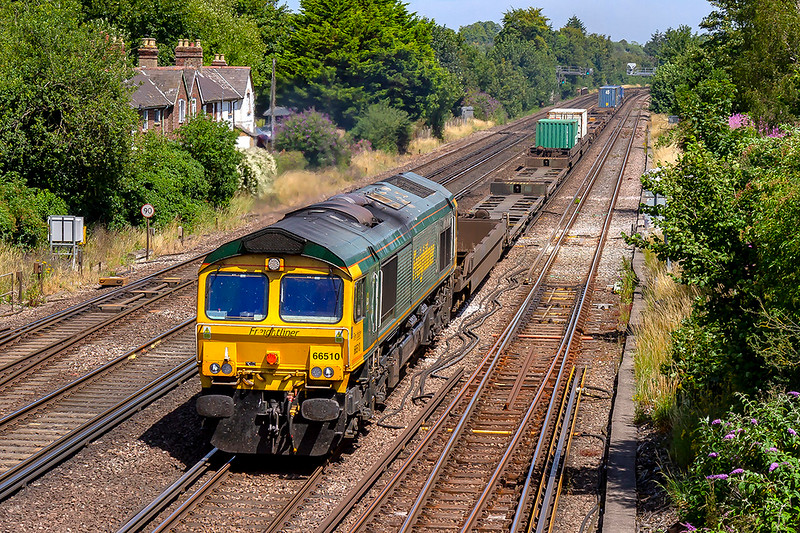 24th Jul 2019:  Running over 30 minutes late at Worting Junction is the 06.08 from Leeds to Southampton Maritime, 4O90 today is in the hands of 66510 which is not being taxed by an almost empty train.