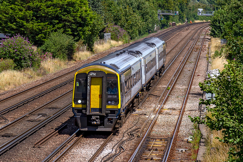 24th Jul 2019:  It is now almost more common to see a SWR class 159 to be in the new livery rather than the old SWT scheme.  159018 forming 1V35 the 12.50 Waterloo to Yeovil Pen Mill is at Worting Junction