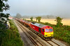 23rd Jul 2019: Luck was with me today as an early start alowed me to see the the oil train to Theale was running very late giving me time to get out for a shot and also that thick mist over the B & H  started to clear at just the right iime,  Phew!!   6A11 is running 156 minutes late as it passes through to site of Edington & Bratton station  with the oil from Robeston to Theale