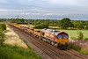 21st Jul 2019:  66012 is nearly home as it works 6W02 the 16.42 from Gloucester Yard Junction to Westbury through Heywood.  The consist contained a mixture of old wooden sleapers, spent ballast and empties !