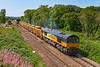 23rd Jul2019:    Colas Rail Freight 66847 named Terrey Baker, after one of their drivers, is nearing Hawkeridge Junction as it powers 6M50 from Westbury to Studd Farm in Leicestershire.  .The IOAs are to be refilled with track ballast and brought back to top up the virtual quarry.