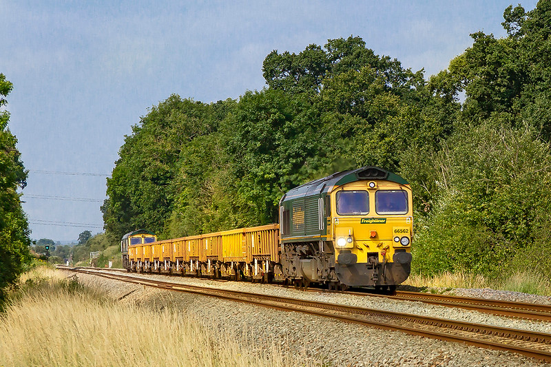 14th Jul 2019:  Nearing Masters Crossing in Fairwood is 66562 working 6Y40 ftom Newton Abbot to Westbury.  On the other end is 66618