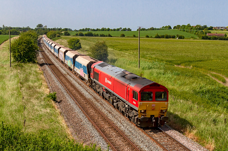 28th Jun 2019:  7O40 is the Friday only service from Merehead to Eastleigh today in the hands of 59206.  Now that the 592s are all up for sale perhaps this may be the last time that it works this service.  Pictured from Granada Bridge on the Warminster Bye Pass.