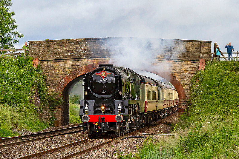16th Jun 2019:  The  'English Riviera Express' is captured as it passes under the bridge on Church Road in Heywood near Westbury.  1Z27 is being powered by Southern Railway West  Country Pacific 34046  that is now carrying it's correct name of  'Braunton'.  Starting from Bristol Temple Meads it is heading for Kinswear in Devon.