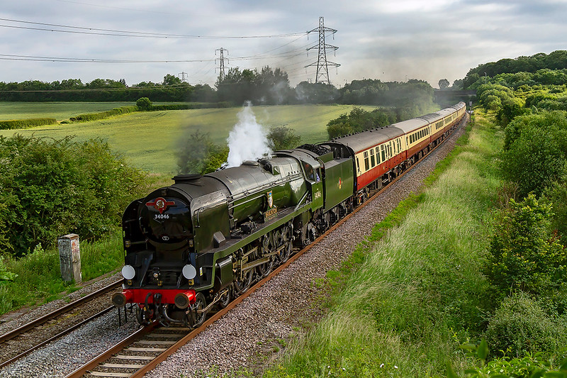 26th Jun 2019:  The 'Dorset Coast Explorer' with Southern Railway West Country Pacific 34046 'Braunton' providing thr urge is pictured as it accellerates away from Clink Road Junction after a Frome stop.