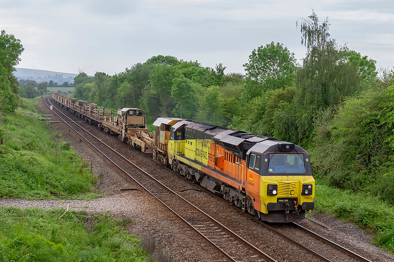 2nd June 2019:  Having travelled from Blatchbridge Junction to Taunton to reverse  6C97 , that is powered by 70802 ,is now working  to Bescot via Westbury.  Pictured here as it runs away from Hawkeridge Junction and through Heywood