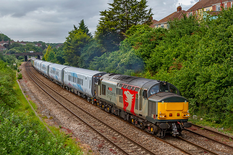 3rd Jun 2019:  Running 110 minutes lattetreSr through Parson and missing the earlier sun is 37601 'Pegasus' at the head os 5Q41. The new five Mk5 Trans Penine Express coaches are being taken to Manchester International Depot from Portbury Dock.  At the rear are six barrier coaches to provide the necessary braking force.