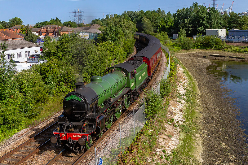 27th Jun 2019:  The Steam Dreams excursion from Princes Rizborough to Weymouth is captured here as it takes the Romsey line at Redbridge.  !Z46 is powered  by LNER B1. 61306 'Mayflower', 47245 is out of sight at the rear.