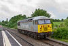 13th June 2019:  On a very grey and damp day grey is not the ideal colour for an engine to be when to want a picture it.  DCRail Group 56103 is captured at Dilton Marsh as it travels as 0Z01 from Eastleigh to Westbury