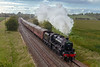 20th Jun 2019:   The return leg of the Steam Dreams tour from Paddington to Bristol was routed via Swindon but the return is via Salisbury.  1Z24 Powered by LMS Black 5 44781 started from Bristol Temle Meads at 17.35 and is on time as it breasts the climb to Upton Scudamore and passses under the bridge on the Warminster By Pass.  If it had been a few minutes later the area would have been in sunlight.