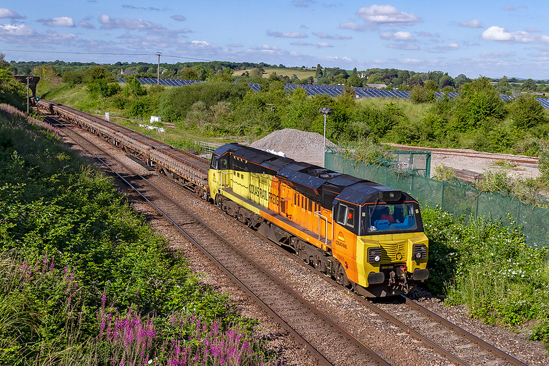 30th Jun 2019:  70805 is leading on 6C20 from Llanwern West Junction to Westbury Down Yard.  The front half of the long rake of YWA waggons is loaded with removed  rack sections and 66847 is at the other end as the train passes through Hawkeridge Junction