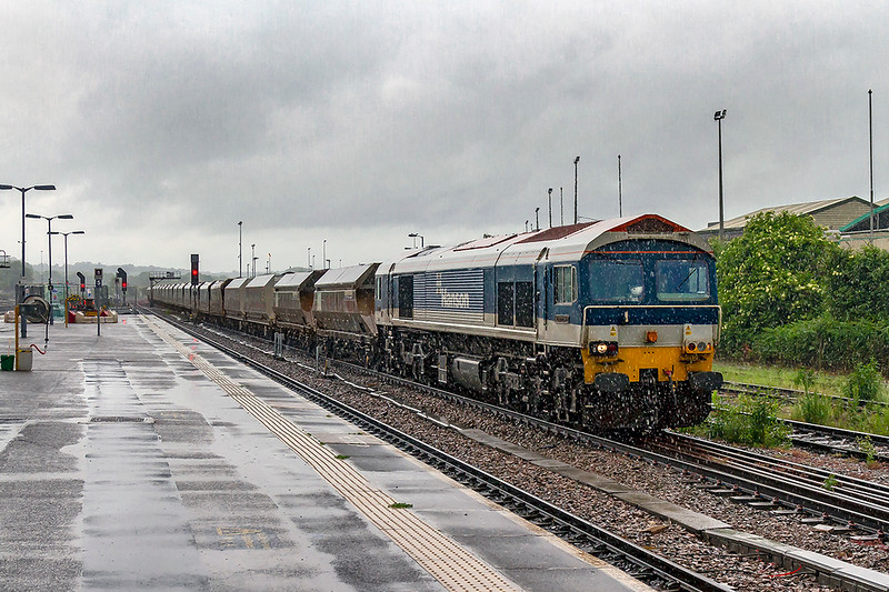 7th Jun 2019:  On a cold and very wet June day 59103 'Village of Mells' runs through Westbury station is it hauls 7B12 the 11.23 from Merehead to Wootton Bassett