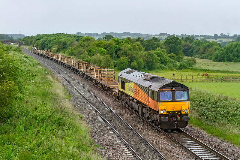 18th Jun 2019:  With it raining again 66848 is running between Fairwood Junction and Westbury as it brings an empty LWR train from Par to Westbury.