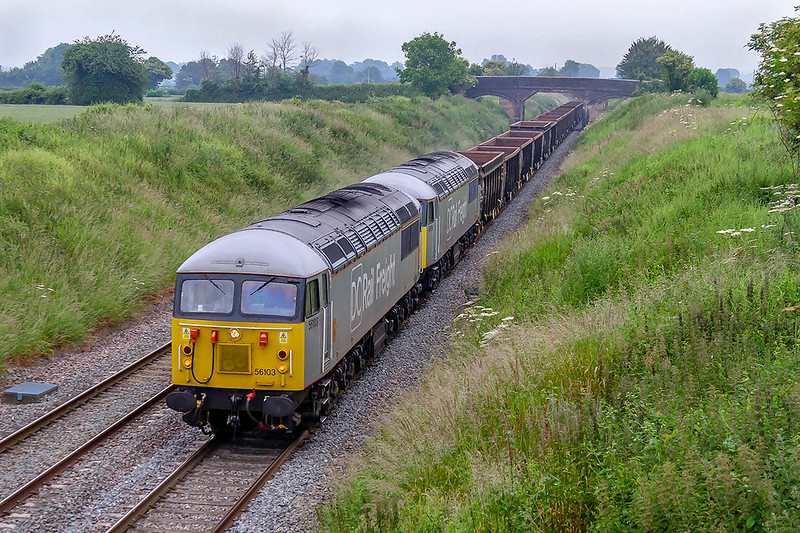 24th Jun 019:  A very welcome change is to see a pair of 56s on the Berks & Hants line.  Passing Lambourn Lane in Edington are 56103 & 56091 on the point of 6Z18 from Willesden DC Sidings th Westbury Down Yard.