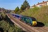 26th Mar 2018:  Castle Class HST is tasked with working 2U08 the 08.41 from Weston Super Mare to Cardiff.  Looking good on the front is one of the only two power cars to be painted in the GWR green livery and with metal GWR logos on the side.  The Welsh Dragon has been redesigned with a Yellow front to the dragon in recognition of the success of Geraint  Thomas