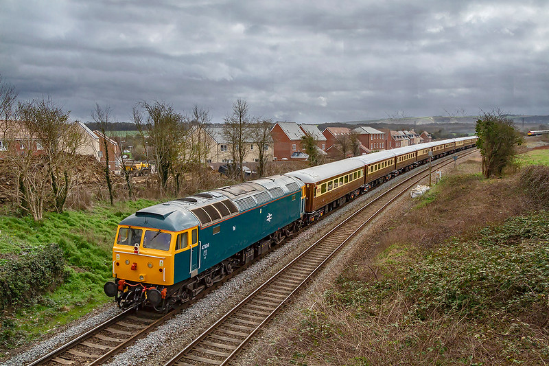 16th Mar 2019:  Bringing up the rear of the 'Statesman' tour from Crewe to Portsmouth Harbour is 47614 that was originally D1733 the  first Class 47  to be painted into 'Monastic Blue' that was later to become the standard colour used by BR on all locomotives.and coaching stock.  Just visible on the right is 59201 on the front of the 'Somerset Strimmer' tour to Cranmore from Victoria.