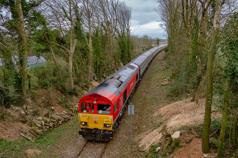 16th Mar 2019:  'The Somerset Strimer' railtour started from Victoria at 07.48 and via the Berks & Hants line  travalled to Avonmouth.  It did not stop there but headed to the final destination at Cranmore staton on the East Somerset Railway.  Top 'n Tailed by 59201 & 59206 the 12 coach train is pictured as it arrives at Cranmore. The return to Victoria also went via the B & H but not iefore it had traversed ar the lines in and out of Merehead Quary.
