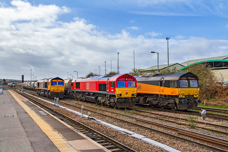13th Mar 2019:  Variety at Westbury.  66846 is arriving  from Cardiff Canton as a LE move. 66009 is shunting. 66773 has come in from Eastleigh and will shortly work 6M40 to Stud Farm.  In the distance is 59005 at the head of 7B12 from Merehead to Wootton Bassett.  Out of sight behind are 3 Colas 70s and another Colas 66.  Shortley before a DBC 592 had worked a long train of empty KEAs from Swindon to Whatley through the down loop on the other side of the station.