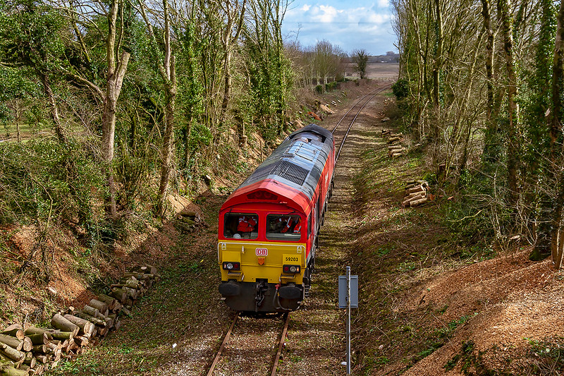 7th Mar 2019:  In preparation for a rail tour on 16th March to the East Somerset Railway at Cranmore 59203 his arriving at the end of the Network Rail controlled line from Witham Friary.  Not used since a tour went to Cranmore in 2012 the line has had to be cleared of all the trees and undergrowth the results of which can be seen at the track side. 0Z59 is a Refresher from Westbury to Cranmore