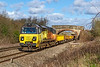 17th Mar 2019:  Taken from the foot crossing at Hweywood 70807 is leading on a quite long train of JNAs and Auto ballesters has 70817 at the rear.  Starting from Bristol West Junction a couple of minutes late at 09.12 it wa still 2 minutes late when it arrived at it's destination in Westburys