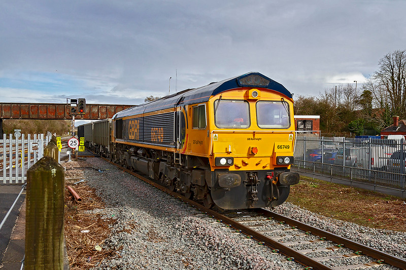 4th Feb 2019:  6V42 from Wellingborough to Whatley Quarry is normally routed through Westbury's platform 2 and with a surprising patch of sunlight  it could not have been better BUT.  As usual on God's Worst Railway the passenger trains were all running late which resulted in 66749 having to travel  via the Down Loop.  Sod's Law again.