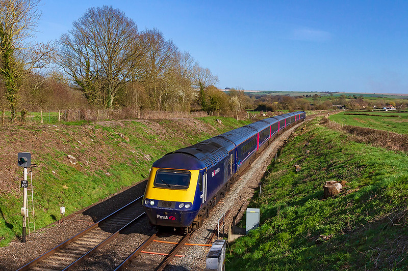 25th Mar 2019: The 14.03 from Paddington to Penzance  is entrusted to an HST today.  43156 and 43018 on the rear of 1C84 are captured  as they run through Great Cheverell.